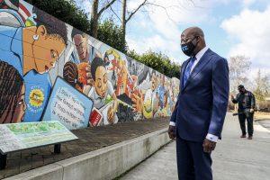 Georgia Senatorial candidate Reverend Raphael Warnock looks at a mural