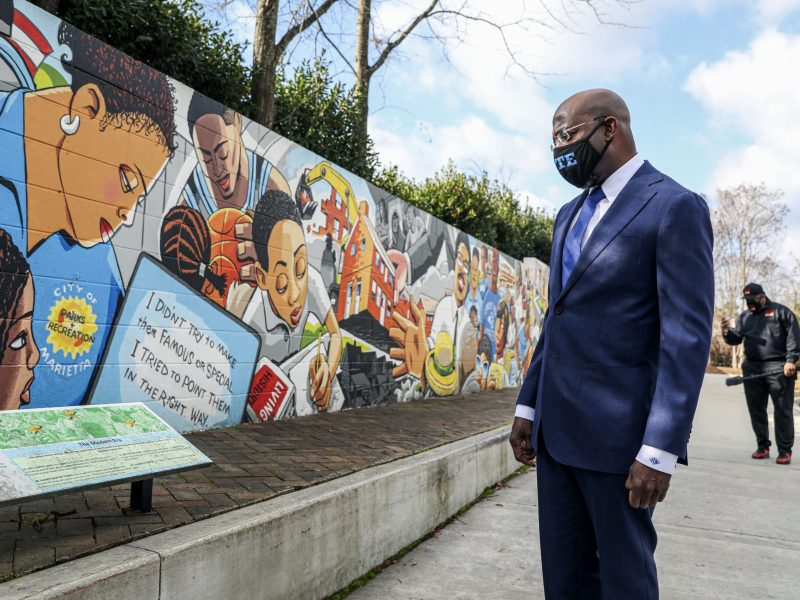 Georgia Senatorial candidate Reverend Raphael Warnock looks at a mural