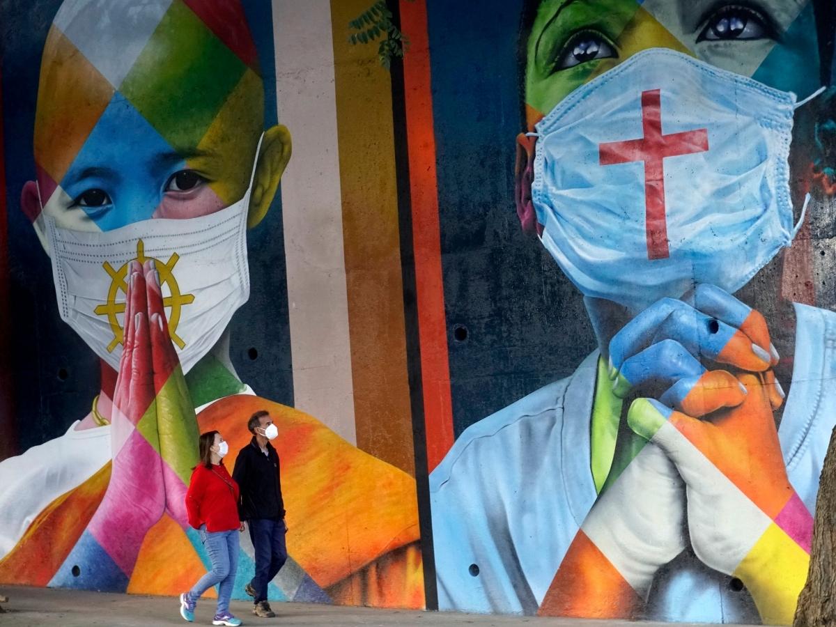 A mural showing children wearing face masks