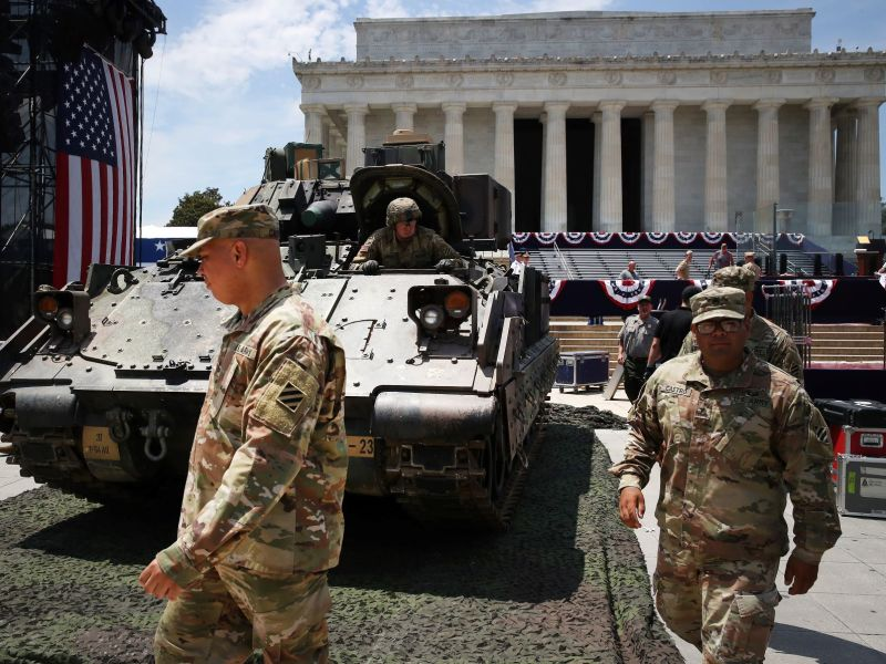 Members of the US Army finish parking a Bradley fighting vehicle in front of the Lincoln Memorial