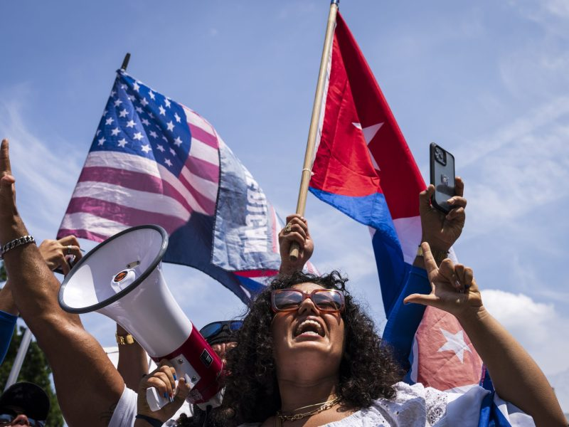 Cuban protestors and supporters rally outside the Cuban Embassy during