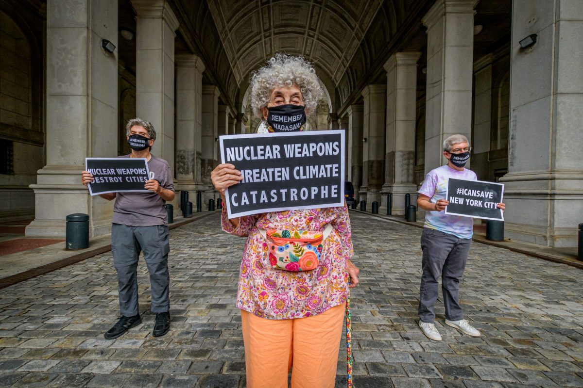 Nuclear disarmament protesters holding signs