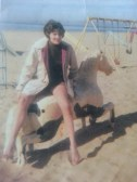 Mom on a little rocking horse - playground
