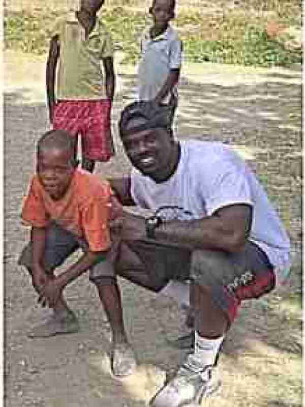 Christian Russell and his Haitian friends