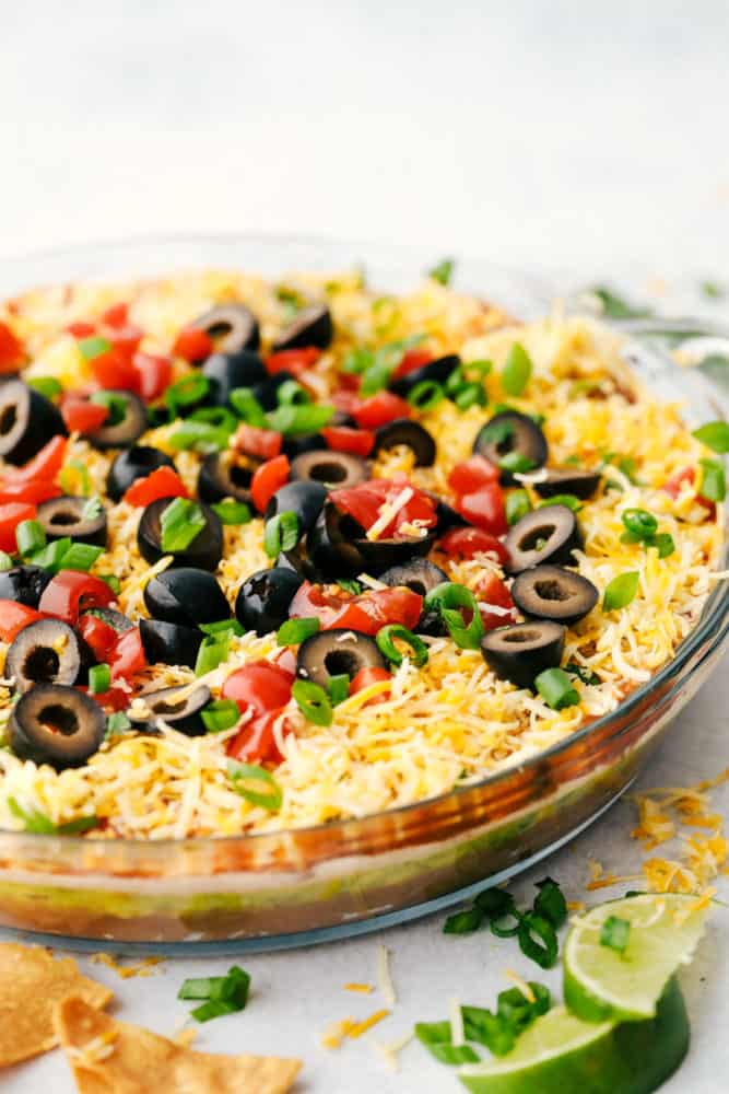 7 layer dip in a clear dish.