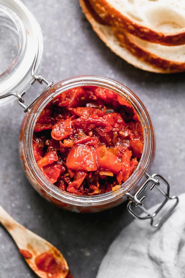 Overhead shot of tomato jam in a jar.