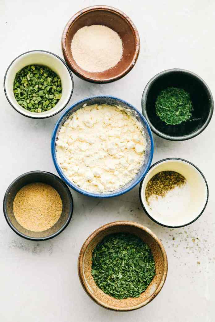 Making Homemade Ranch Seasoning with the seasonings in different bowls.