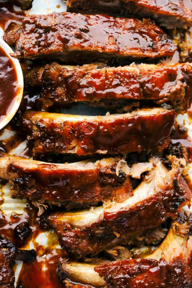 Segmented ribs with sauce showing texture.