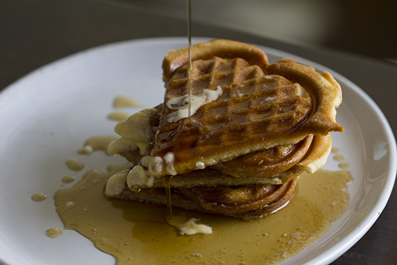 Waffles dripping with maple syrup