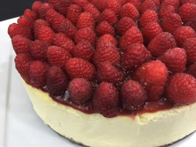 Awesome Creamy Delicious New York Cheesecake with Raspberry topping