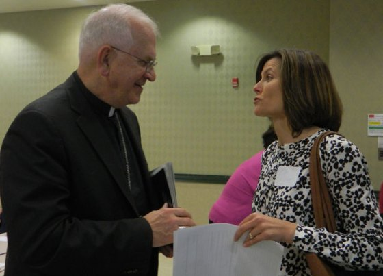 Archbishop Joseph E. Kurtz spoke to Ellen Wichmann, a parishioner of St. Michael Church, before the Respect Life Archdiocesan-Wide meeting May 14 at St. Agnes Church. (Record Photo by Ruby Thomas)
