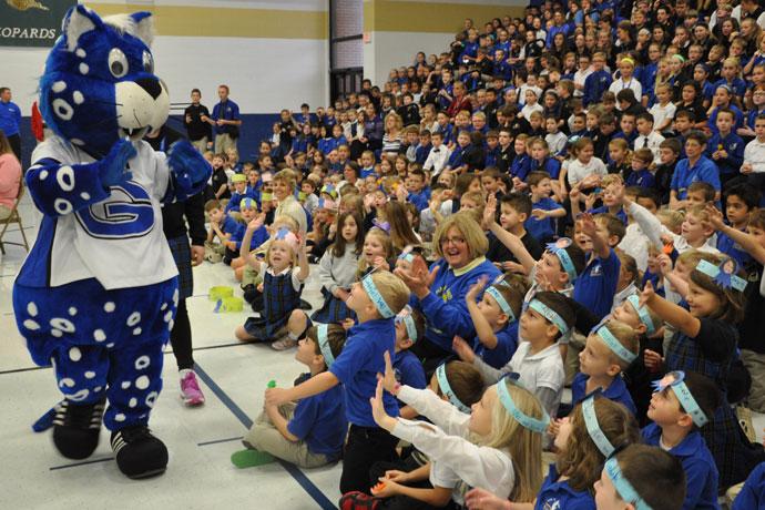 "St. Gabriel School mascot ""Big G"" talks to students at the school's Blue Ribbon celebration Nov. 12."