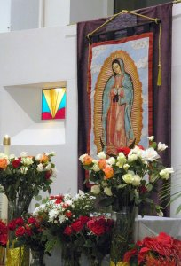 An image of Our Lady of Guadalupe in front of  which parishioners prayed Dec. 12 at St. Edward Church.
