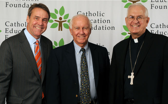 Daniel C. Ulmer Jr., center, and his family have made a $500,000 gift to the Catholic Education Foundation. He is pictured with the foundation president, Richard A. Lechleiter, left, and Archbishop Joseph E. Kurtz. (Photo Special to The Record)