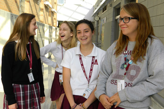 Assumption High School juniors, from left, Lydia Clements, Maggie Meyers and Logan Mattingly, and senior Grace Tarter, right, are officers in the school's Green Dot Club, part of a program that teaches violence and bullying prevention. (Record Photo by Ruby Thomas)