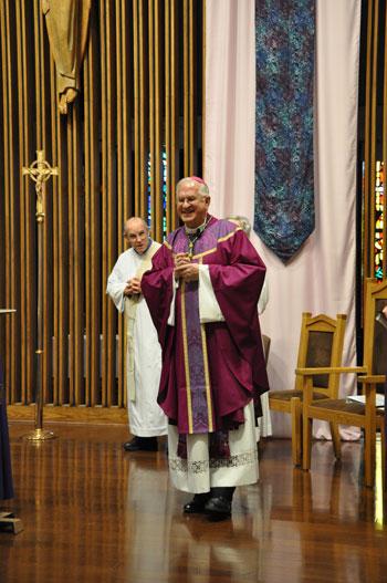Archbishop Joseph E. Kurtz celebrates Mass at the new St. John Paul II Church Dec. 20. (Record Photo by Jessica Able)
