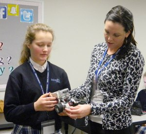 Mercy Academy freshman Tessa Duncan, left, and teacher Kristen Chavez worked with a robot built by students during an introductory STEM class.  (Record Photo by Ruby Thomas)