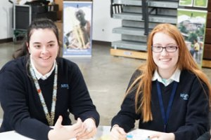Ashley Baker, left, and Caitlyn Tumey, both juniors at Mercy Academy, participated in a table discussion at the Catholic Relief Services Rice Bowl kick-off luncheon held at DeSales High School Feb. 2. (Record Photo by Jessica Able)