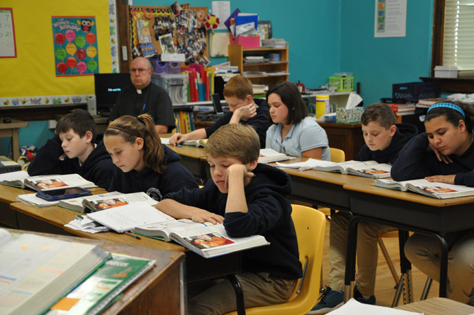 Middle school students at St. Catherine Academy in New Haven, Ky., read from their books during class on Nov. 5, 2015. The school in Nelson County has seen a 15 percent increase in student enrollment during the course of the last year. (Record File Photo by Jessica Able)