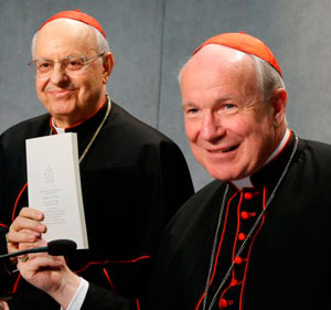 """Cardinal Lorenzo Baldisseri, general secretary of the Synod of Bishops, and Austrian Cardinal Christoph Schonborn, holds a copy of Pope Francis' apostolic exhortation on the family, """"Amoris Laetitia"""" (""""The Joy of Love""""), during a news conference for the document's release at the Vatican April 8. The exhortation is the concluding document of the 2014 and 2015 synods of bishops on the family. (CNS photo/Paul Haring)"""