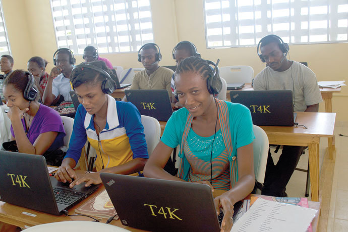 Students at the St. Francis School of Technology in Jérémie, Haiti, completed classwork on laptops. (Photo Special to The Record)
