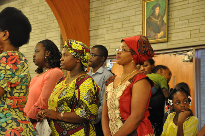 Immaculee Ndagiglimana, Angel Ingalsire and Estella Ndayizeye, from left, stand during the service.
