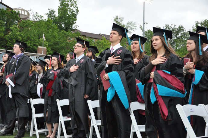 Graduates of Bellarmine University said the Pledge of Allegiance at the school's graduation May 14 at Owsley B. Frazier Stadium. (Record Photo by Jessica Able)