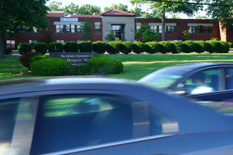 Cars sped past St. Margaret Mary School during rush hour on Shelbyville Road earlier this week.  The school is beginning an experiment to naturally filter air pollution on its campus.