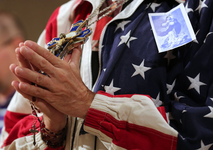 A worshipper holding a rosary and crucifix prays during a July 4 Mass celebrated at the Basilica of the National Shrine of the Immaculate Conception in Washington on the final day of the U.S. bishops' Fortnight for Freedom campaign. (CNS photo/Bob Roller)