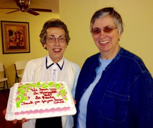Sister Margaret Held, left, and Paula Merrill are pictured in an undated photo with a cake celebrating their service.