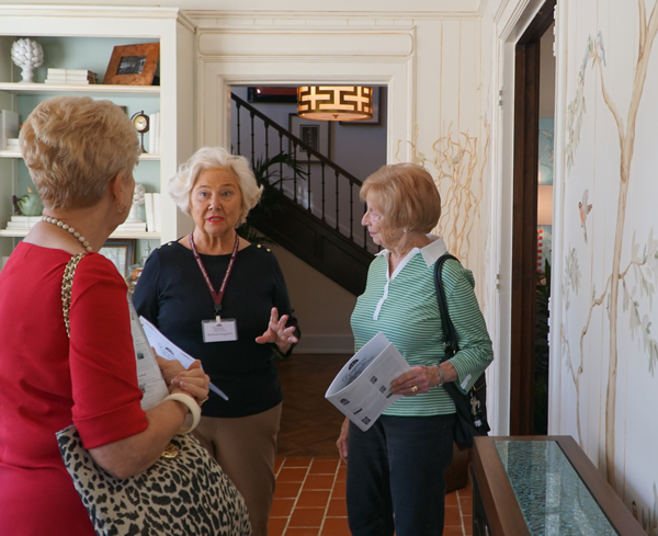Volunteer Melinda Hargadon, center, discussed a room designed by Carriage House Interiors and hand painted by Sandy Kimura during the Bellarmine University Women's Council Designers' Show House tour Sept. 12. The annual project raises funds for Bellarmine student aid. This year's show house, located in the Highlands, will be open through Sept. 25. (Record Photo by Marnie McAllister)