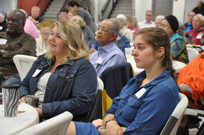 Carri Wright, left, a parishioner of St. Margaret Mary Church, and Kate Middleton, right, a parishioner of St. Michael Church, listened to Archbishop Joseph E. Kurtz's keynote address at the Archdiocese of Louisville's Life Conference. The conference, which drew more than 200 attendees, was held Oct. 22 at St. Michael Church in Jeffersontown. (Record Photo by Jessica Able)