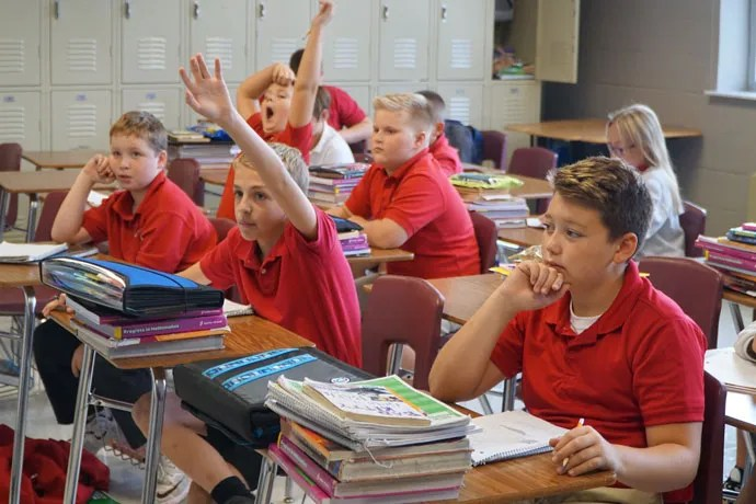 St. Paul School sixth graders participated in a class on Sept. 15. The Dixie Highway school has increased its enrollment over last year by 26 students. Pictured from left in the front row are Tyler Votaw, Grant McDonald and Jaxon Bohannon and in the back row from left are Scott Forish and Landon Sims. (Record Photo by Jessica Able)