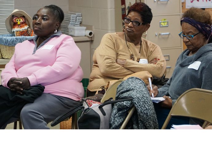 Immaculate Heart of Mary Church members, from left, Sheila Kelley, Patricia Powell and Alieda Pleasants listened and took notes during a workshop at the Catholic Women's Conference Nov. 5 at St. Patrick Church in Eastwood. (Record Photo by Ruby Thomas)