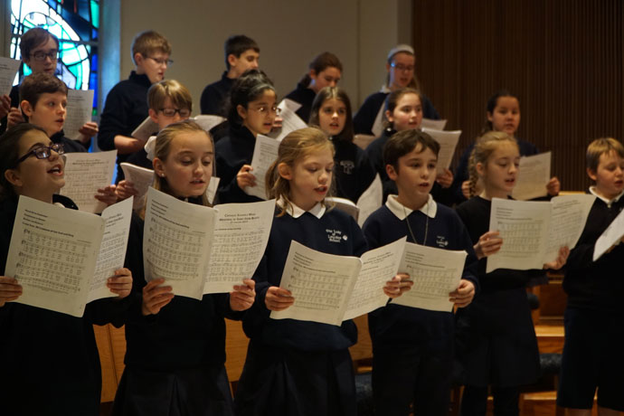 """Members of the Our Lady of Lourdes School choir sang the opening hymn during the Archdiocese of Louisville's annual Catholic Schools Week Mass Jan. 31 at Our Lady of Lourdes parish. National Catholic Schools Week is celebrated Jan. 29 to Feb. 4 and the theme is """"Catholic Schools: Communities of Faith, Knowledge, and Service."""" (Record Photo by Jessica Able)"""