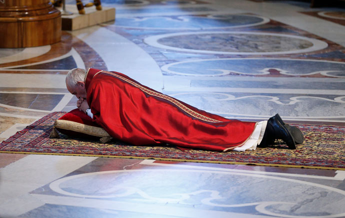 Pope Francis lies prostrate as he leads the Good Friday service in St. Peter's Basilica at the Vatican April 14. (CNS photo/Paul Haring)