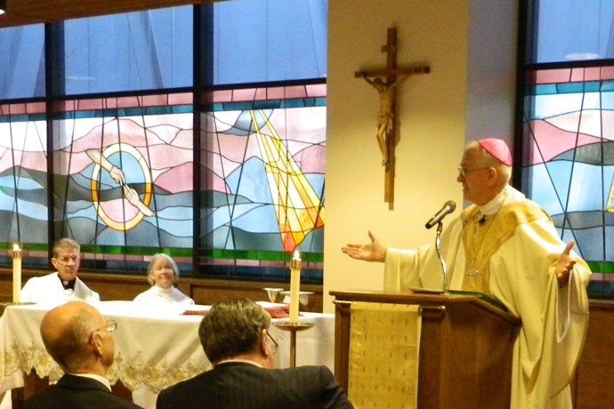 Archbishop Joseph E.Kurtz celebrated Mass in the chapel of Sts. Mary and Elizabeth Hospital in late 2013 after the chapel had been renovated. The renovation included the installation of a new Marian statue and a new tabernacle. The hospital's owner, the Catholic KentuckyOne Health, announced last week that it plans to sell Sts. Mary and Elizabeth, along with several other Louisville-area health-care facilities. (Record File Photo by Marnie McAllister)