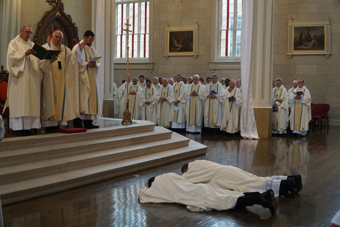 The two ordinands lay prostrate during the Litany of Supplication during the ordination rite at the Cathedral May 27.