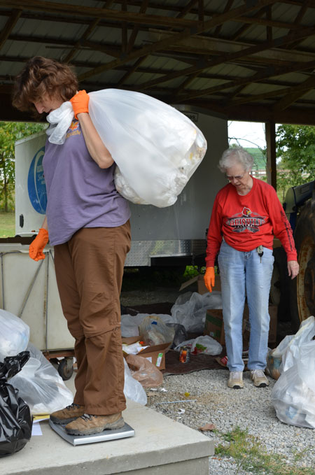 """Carolyn Cromer, left, director of ecological sustainability for the Sisters of Charity of Nazareth, and Sister Rosemarie Kirwan weighed trash during a waste audit conducted by the Sisters of Charity of Nazareth recently. The SCNs participated in a """"Caring for Creation"""" presentation Sept. 12 at St. Francis of Assisi Church. (Photo Special to The Record)"""