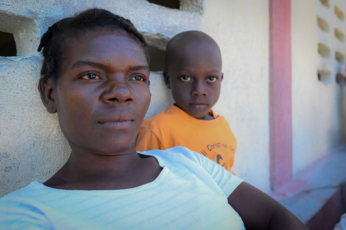 Elda Servius, pictured with her 5-year-old son Benji, had hoped to be among those selected by lottery to receive a water filter from Water With Blessings Nov. 5. Cholera, which can be filtered from unclean water, has already taken her husband's life. They left empty-handed. (Photo Special to The Record by Bryan Woolston)