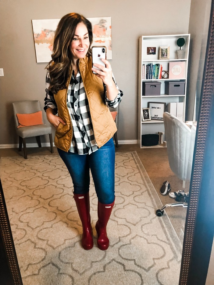 Classic fall look- puffer vest, buffalo plaid, and red hunter boots