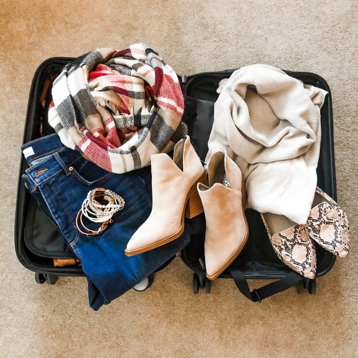 """Fall long weekend getaway capsule- all packed in a 20"""" carry-on and making over 10 outfits. See the entire post at www.therecruitermom.com #falloutfits #fallcapsule #fall2019 #fallcasualoutfits #fallstyle #outfitideas #affordablestyle #weekendstyle"""