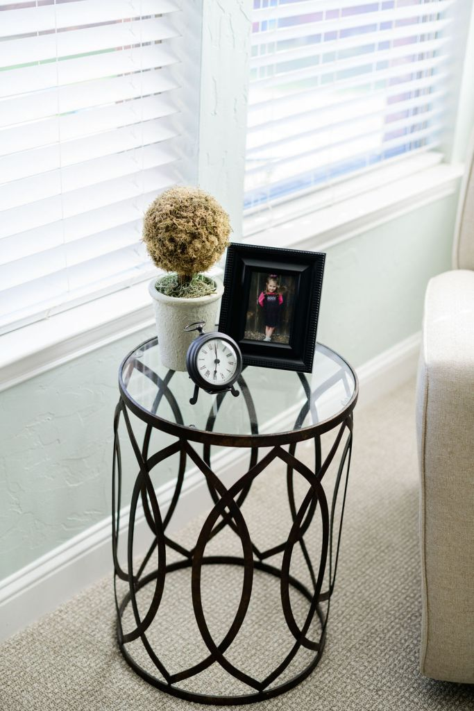 Master Bedroom glass top side table with vignette