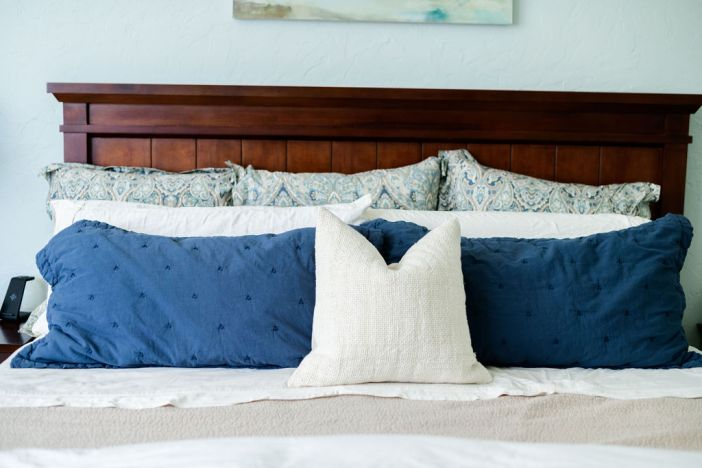 Sherwin Williams Sea Salt paint with dark wood bedroom furniture and Pottery Barn bedding