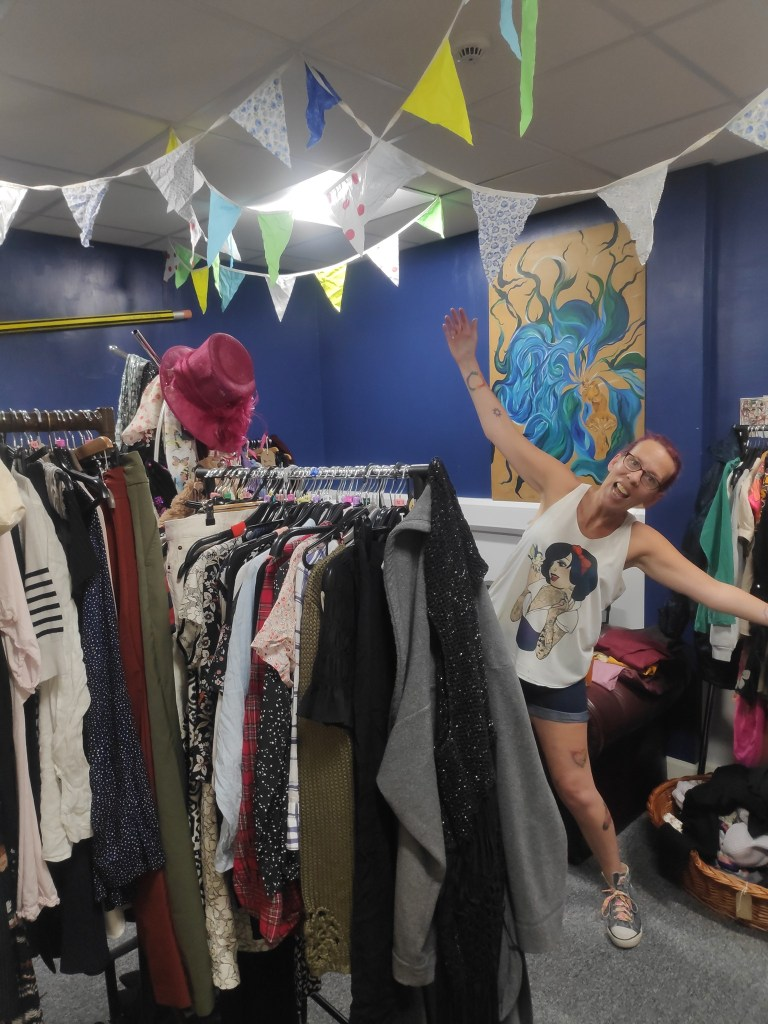 a happy customer at our clothes swap event