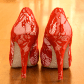 Alluring Amber.   Iconic red lace, silver glitter sole.  Devastatingly good looking.