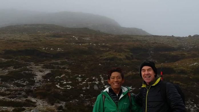 """Mingma Tsiri and Michael Cusack, author of """"Croagh Patrick and the Islands of Clew Bay"""" on the shoulder of Croagh Patrick"""
