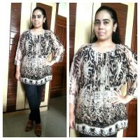 IN A STUNNING ANIMAL PRINT TOP FROM GIA CURVE