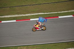 Marc Marquez waves his brothers flag