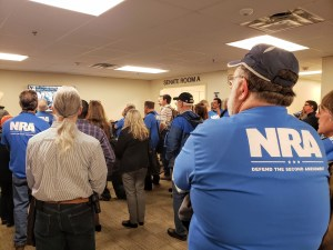 NRA members watch legislative proceedings